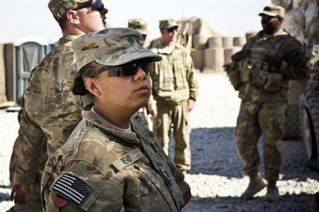 Specialist Joanne Read, of the U.S. Army's Bravo Company, 1st Battalion, 36th Infantry Regiment, First Armored Division, helps unload a resupply truck at Command Outpost AJK (short for Azim-Jan-Kariz - a near-by village) in Maiwand District, Kandahar Province, Afghanistan, January 24, 2013. REUTERS/Andrew Burton