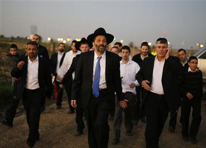Aryeh Deri (C), leader of the ultra-Orthodox Shas party, attends an annual pilgrimage to the gravesite of Rabbi Yisrael Abuhatzeira, a Moroccan-born sage and kabbalist also known as the Baba Sali, in the southern town of Netivot January 14, 2013. REUTERS/Amir Cohen