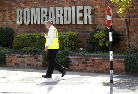 A worker walks past the entrance to the Bombardier plant in Derby, central England, July 5, 2011. REUTERS/Darren Staples