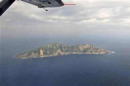 A handout photograph taken on a marine surveillance plane B-3837 shows the disputed islets, known as Senkaku in Japan and Diaoyu in China, December 13, 2012. Picture taken December 13, 2012. REUTERS/State Oceanic Administration of People's Republic of China/Handout