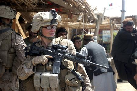 U.S. Marine Lance Cpl. Stephanie Robertson, a member of the female engagement team (FET) assigned to 2d Battalion, 6th Marine Regiment, Regimental Combat Team 7, speaks with local civilians during an engagement mission in Marjah, Afghanistan, in this August 18, 2010 U.S. Marine Corps handout photo. REUTERS/Lance Cpl. Marionne T. Mangrum/U.S. Marine Corps/Handout