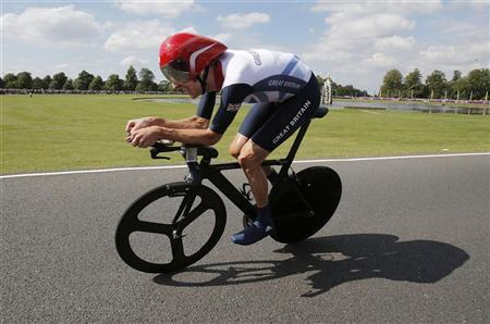 Britain's Bradley Wiggins competes in the men's individual time trial cycling event at the London 2012 Olympic Games August 1, 2012. REUTERS/Christophe Ena/Pool