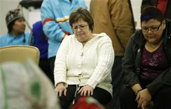 Attawapiskat Chief Theresa Spence (C) takes part in an event in her honour after ending her six-week hunger strike in Ottawa January 24, 2013. REUTERS/Chris Wattie