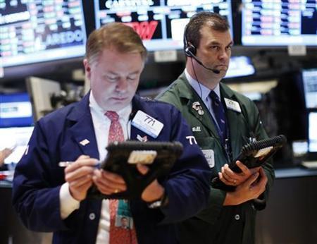 Traders work on the floor of the New York Stock Exchange, January 11, 2013. REUTERS/Brendan McDermid