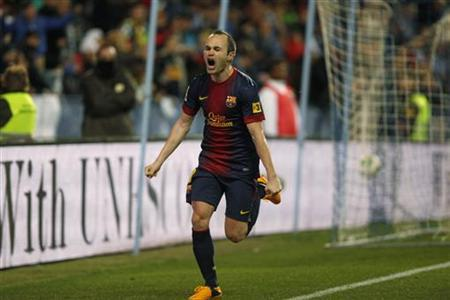 Barcelona's Andres Iniesta celebrates after scoring a goal against Malaga during their Spanish King's Cup quarter-final second leg soccer match at La Rosaleda stadium in Malaga, southern Spain January 24, 2013. REUTERS/Jon Nazca