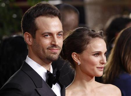 Actress Natalie Portman and partner Benjamin Millepied arrive at the 69th annual Golden Globe Awards in Beverly Hills, California January 15, 2012. REUTERS/Mario Anzuoni