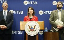 National Transportation Safety Board Chairman Deborah A. P. Hersman (C), standing with Director of the Office of Aviation Safety John DeLisi (L) and Director Office of Research and Engineering Joseph Kolly (R), briefs reporters on the NTSB's ongoing investigative work being done on the malfunctioning JAL Boeing 787 lithium ion battery at their labs in Washington, January 24, 2013. REUTERS/Jonathan Ernst
