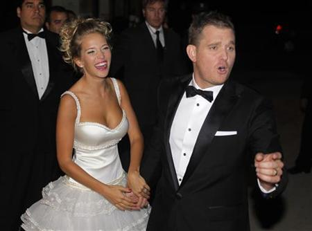Canadian singer Michael Buble and his bride Argentine actress Luisana Lopilato pose for photographers after their religious wedding ceremony at the Villa Maria palace in Marcos Paz, outskirts of Buenos Aires April 2, 2011. REUTERS/Enrique Marcarian