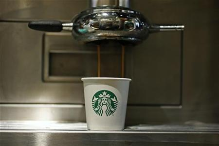 A paper cup is seen in Starbucks' Vigo Street branch in Mayfair, central London January 11, 2013. REUTERS/Stefan Wermuth