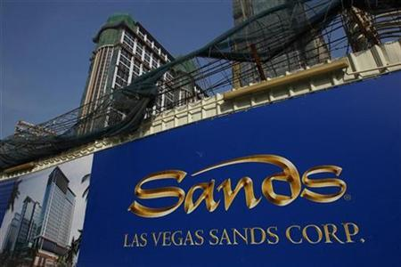 The Las Vegas Sands company logo is seen in front of its construction site in Macau November 14, 2008. REUTERS/Bobby Yip