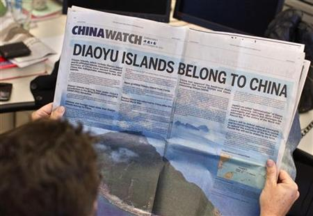 A double page advertisement regarding the territorial dispute between China and Japan over the uninhabited group of islands in the East China Sea -- known as the Senkaku in Japan and Diaoyu in China, is seen in the New York Times in this photo illustration in New York September 28, 2012. REUTERS/Shannon Stapleton/Files