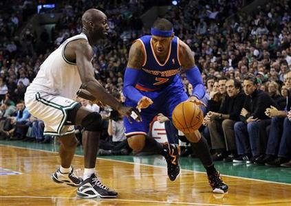 New York Knicks forward Carmelo Anthony (R) drives to the basket around Boston Celtics forward Kevin Garnett in the second half of their NBA basketball game in Boston, Massachusetts January 24, 2013. REUTERS/Brian Snyder