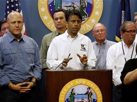 Louisiana Governor Bobby Jindal talks about Tropical Storm Isaac as New Orleans Mayor Mitch Landrieu (L) looks on during a news conference at City Hall in New Orleans, Louisiana, August 27, 2012. REUTERS/Jonathan Bachman