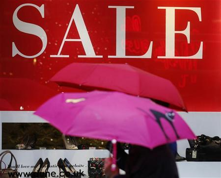 Pedestrians pass a shop in central London December 27, 2012. REUTERS/Luke MacGregor