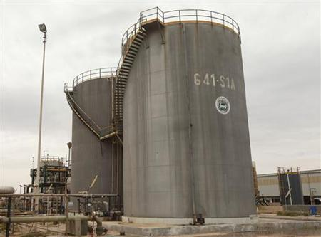 Oil tanks of Zawiya oil refinery are pictured in Zawiya 57km (35 miles) west of Tripoli April 11, 2012. REUTERS/Ismail Zitouny