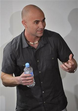 Andre Agassi of the U.S. speaks to journalists at the Australian Open tennis tournament in Melbourne January 25, 2013. REUTERS/Toby Melville