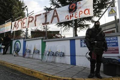 Greek police storm metro workers sit-in, strike goes...