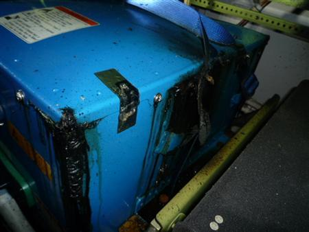 The burnt auxiliary power unit battery is seen in an All Nippon Airways' (ANA) Boeing Co 787 Dreamliner plane which made an emergency landing last week, in this January 17, 2013 handout photo provided by the Japan Transport Safety Board (JTSB) and obtained by Reuters on January 23, 2013. REUTERS/Japan Transport Safety Board/Handout