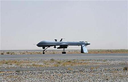 A U.S. Predator unmanned drone armed with a missile stands on the tarmac of Kandahar military airport June 13, 2010. REUTERS/Massoud Hossaini/Pool (AFGHANISTAN - Tags: POLITICS MILITARY)