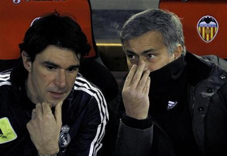 Real Madrid's coach Jose Mourinho (R) talks to assistant coach Aitor Karanka before their Spanish first division soccer match against Valencia at the Mestalla stadium in Valencia, January 20, 2013. REUTERS/Heino Kalis
