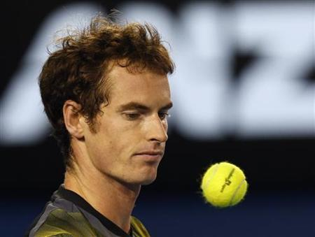 Andy Murray of Britain looks at a ball as he prepares to serve to Roger Federer of Switzerland during their men's singles semi-final match at the Australian Open tennis tournament in Melbourne January 25, 2013. REUTERS/Damir Sagolj