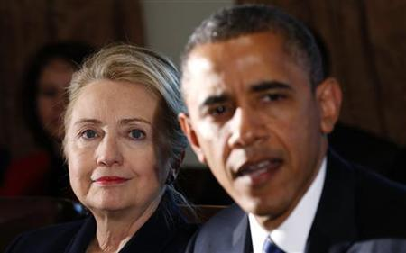 U.S. Secretary of State Hillary Clinton (L) listens to U.S. President Barack Obama speak during a meeting with members of his cabinet at the White House in Washington November 28, 2012. REUTERS/Kevin Lamarque/Files