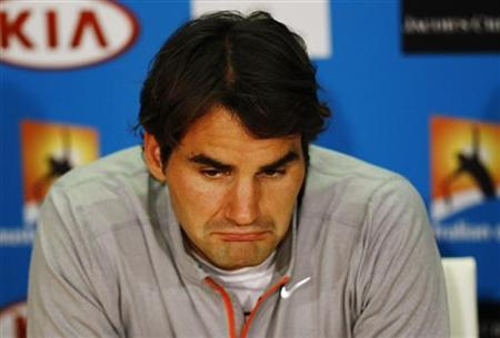 Roger Federer of Switzerland attends a news conference after he was defeated in his men's singles semi-final match by Andy Murray of Britain at the Australian Open tennis tournament in Melbourne January 26, 2013. REUTERS/Navesh Chitrakar
