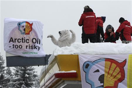 Greenpeace protesters shut down a Shell petrol station during the annual meeting of the World Economic Forum (WEF) in Davos-Wolfgang January 25, 2013. REUTERS/Denis Balibouse