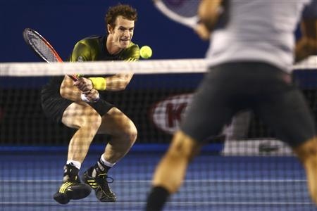 Andy Murray of Britain plays a shot to Roger Federer of Switzerland during their men's singles semi-final match at the Australian Open tennis tournament in Melbourne January 25, 2013. REUTERS/Mark Kolbe/Pool