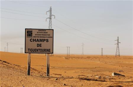 A road sign indicating the Tiguentourine gas plant, about 130 km from the Algerian and Libyan border, is seen where Islamist militants held foreigners hostage, January 19, 2013.REUTERS/Louafi Larbi