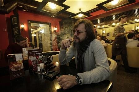A man smokes a cigarette at a cafe in central Krasnoyarsk in Siberia January 24, 2013. REUTERS/Ilya Naymushin