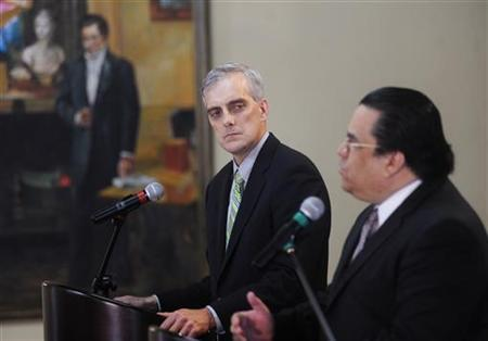 U.S. Deputy National Security Advisor Denis Mcdonough (L) listens to Honduras' Foreign Minister Arturo Corrales during a joint news conference in Tegucigalpa November 28, 2012. REUTERS/Jorge Cabrera/Files
