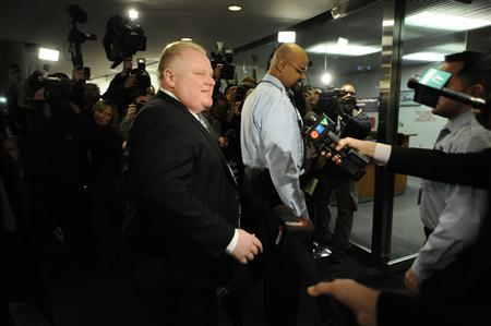 Toronto Mayor Rob Ford walks to his office after winning his conflict of interest appeal in Toronto, Ontario on January 25, 2013. Ford on Friday won an appeal against a ruling that was set to remove him from office, allowing him to see out his four-year term and ending a showdown that has transfixed City Hall.REUTERS/Jon Blacker
