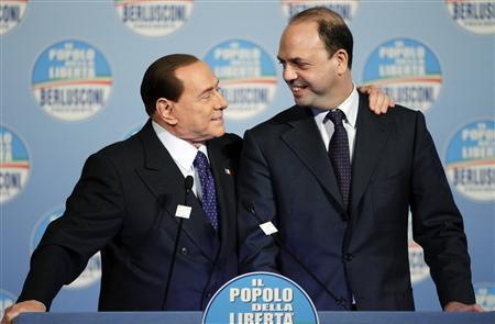 Former Italian Prime Minister Silvio Berlusconi (L) smiles next to People of Freedom Party (PDL) secretary Angelino Alfano as he arrives for a political rally in downtown Rome January 25, 2013. REUTERS/Max Rossi