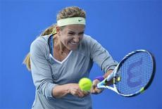 Victoria Azarenka of Belarus hits a shot during a practice session at the Australian Open tennis tournament in Melbourne January 25, 2013. REUTERS/Toby Melville