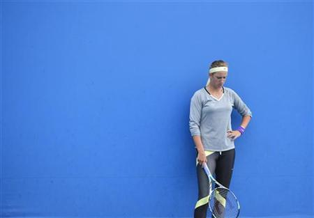 Victoria Azarenka of Belarus attends a practice session at the Australian Open tennis tournament in Melbourne January 25, 2013. REUTERS/Toby Melville