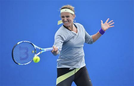 Victoria Azarenka of Belarus hits a return during a practice session at the Australian Open tennis tournament in Melbourne January 25, 2013. REUTERS/Toby Melville