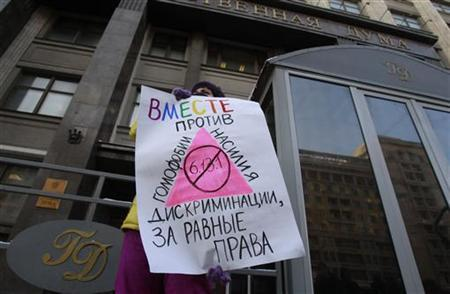 A gay rights activist holds a placard during a protest outside the Duma, Russia's lower house of Parliament, in Moscow January 22, 2013. REUTERS/Sergei Karpukhin/Files