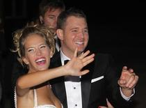 Canadian singer Michael Buble and his bride Argentine actress Luisana Lopilato wave to fans after their religious wedding ceremony at the Villa Maria palace in Marcos Paz, outskirts of Buenos Aires April 2, 2011. REUTERS/Enrique Marcarian