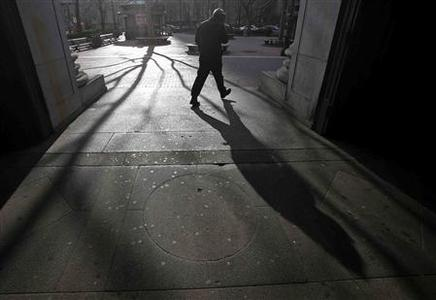 A man casts his shadow walking out of the City Hall subway station in New York January 23, 2013. An Arctic blast gripped the U.S. Midwest and Northeast on Tuesday, with at least three deaths linked to the frigid weather, and fierce winds made some locations feel as cold as 50 degrees below zero Fahrenheit. REUTERS/Carlo Allegri