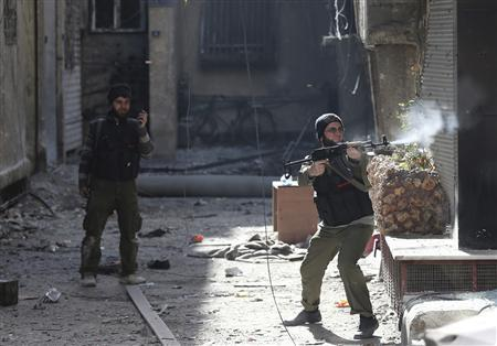 A Free Syrian Army fighter fires his rifle during heavy fighting in Mleha suburb of Damascus January 25, 2013. REUTERS/Goran Tomasevic