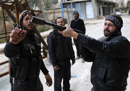 A Free Syrian Army fighter uses a shotgun to fire a homemade grenade at Syrian Army soldiers during a fight in the Arabeen neighbourhood of Damascus January 24, 2013. REUTERS/Goran Tomasevic