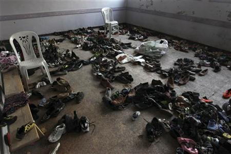A room is seen filled with second-hand shoes to be distributed to residents as part of humanitarian aid at a school in Aleppo January 23, 2013. REUTERS/Muzaffar Salman