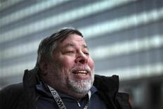 Apple co-founder Steve Wozniak talks to a reporter as he and his wife Janet wait in line overnight with customers to purchase the new iPad at the Apple Store in Century City Westfield Shopping Mall in Los Angeles, California March 16, 2012. REUTERS/David McNew