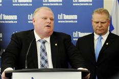 Toronto Mayor Rob Ford speaks to the media at City Hall supported by his brother, Councillor Doug Ford (R) after winning his conflict of interest appeal in Toronto, Ontario, January 25, 2013. REUTERS/Jon Blacker (CANADA - Tags: POLITICS)