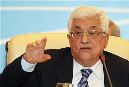Palestinian President Mahmoud Abbas gestures as he speaks during the Arab Peace Initiative Committee Meeting in Doha December 9, 2012. REUTERS/Mohammed Dabbous