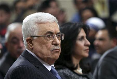Palestinian President Mahmoud Abbas attends Christmas Midnight Mass at the Church of St. Catherine, which is connected to the Church of the Nativity, in the West Bank town of Bethlehem December 25, 2012. REUTERS/Abed Al Hashlamoun/Pool