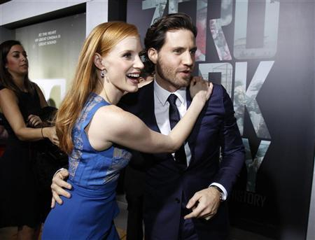 Cast members Jessica Chastain and Edgar Ramirez greet each other at the premiere of ''Zero Dark Thirty''at the Dolby theatre in Hollywood, California December 10, 2012. The movie opens in the U.S. on January 11. REUTERS/Mario Anzuoni