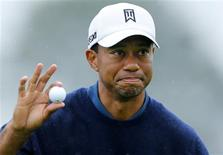 U.S. golfer Tiger Woods holds up his ball after making a birdie to end his round 11-under par during second round play at the Farmers Insurance Open in San Diego, California, January 25, 2013. REUTERS/Mike Blake