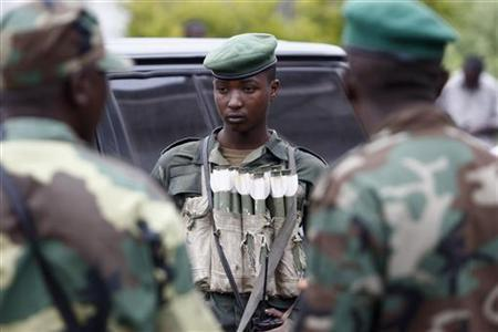 M23 rebel fighter wears an ammunition pouch on his chest during a news conference in Bunagana in eastern Democratic Republic of Congo January 3, 2013. REUTERS/James Akena